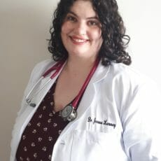 Dr. Jenna in a white coat